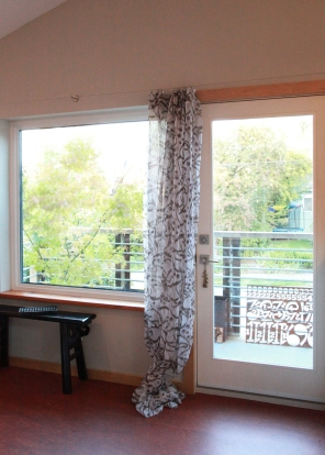 View from the office/ guest bedroom out to garden balcony.