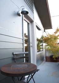 Front garden balcony adds outdoor space and opportunity for gardening.