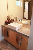 Bathrooms are simple and elegant, with concrete countertop made on site.