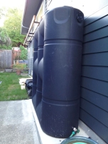 Large cisterns capture rainwater for use in the garden. Photo by Becky Chan.
