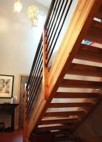 Engineer lumber (glulam beams) used for a cost effective open stair design.