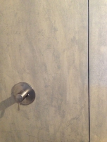 Stained and sealed hardipanel (fiber cement siding product) used for tiling the shower. Photo by Parie Hines.