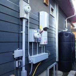 The north side of the house has much of the technical infrastructure for the home. Photo by Becky Chan.