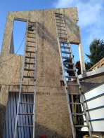 Structural insulated panels (SIPS) during installation. Photo by Becky Chan.