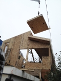 The roof panels are craned into place. Photo by Becky Chan.