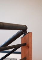 Stair railing posts milled from door headers salvaged onsite.
