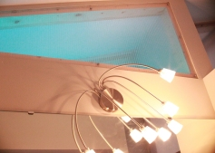 Translucent panels above the bathroom and pantry have glowing LED light strips, which allow for changing colors.