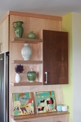 A wall of shelves and cabinets.