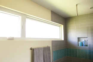 Long windows continue into the shower.