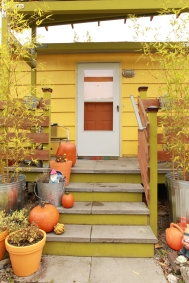 Stairs up to the front door. Concrete pavers are an inexpensive and durable stair and porch surface.