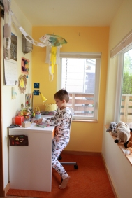A pocket of space at the end of a hall becomes a perfect kid office.