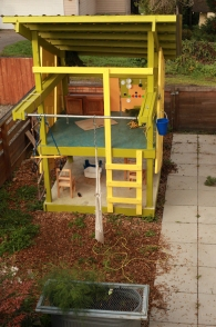 "The ""Citrus Spy Nest"" is a small play house in the back yard."