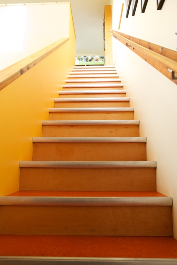 The commute to the home office -- an inexpensive combination of marmoleum, plywood, and metal nosing.
