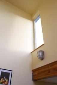 Corner windows wash the walls with light.